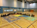 largest text formation made of paper airplanes (16)