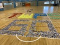 largest text formation made of paper airplanes (9)
