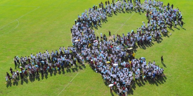 Largest Human Formation Of A Blue Ribbon