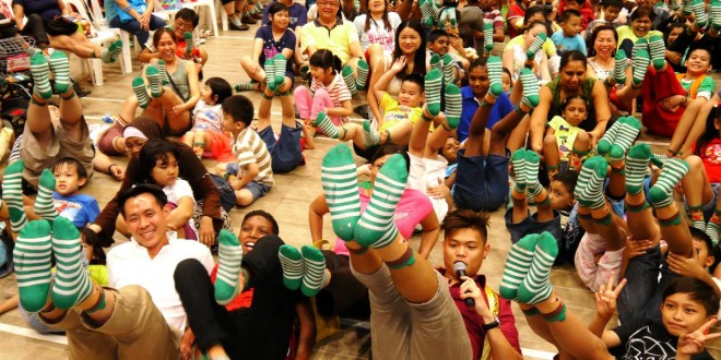 Most Number Of People Posing With Socks In A Similar Pattern