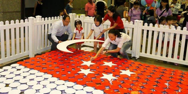 Largest National Flag Made Of Milk Tins