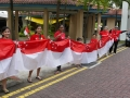 Longest Line Of People Walking With The National Flag
