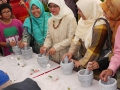 Most Number Of People People Pounding With Mortars And Pestles Together