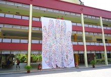 Largest Logo Made Of Handprints