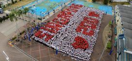 Largest Human Formation Of A Slogan